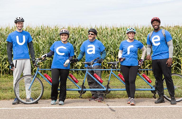 UCare bike team in front of corn field
