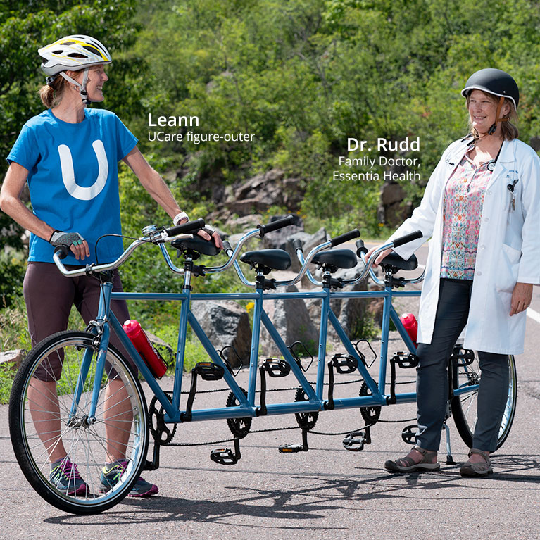 UCare de-complicator and Essentia Health doctor with bike