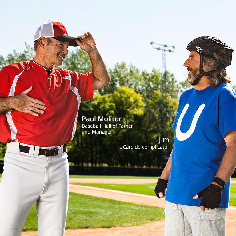 Paul Molitor giving baseball signs to Jim, UCare de-complicator, on a baseball field