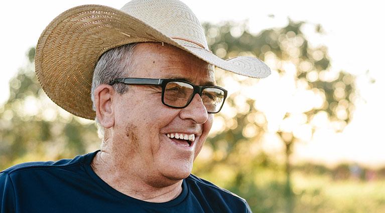 smiling man wearing a cowboy hat