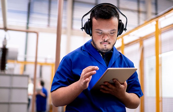 man wearing headphones on tablet