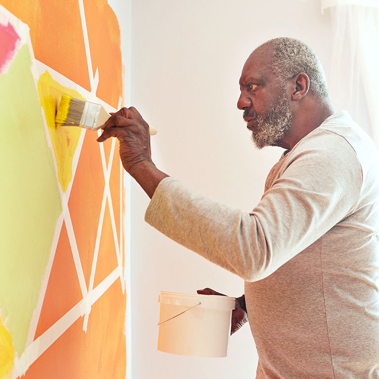 man painting colorful wall