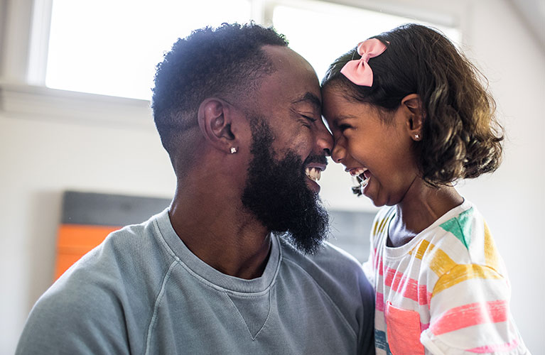 man and girl laughing