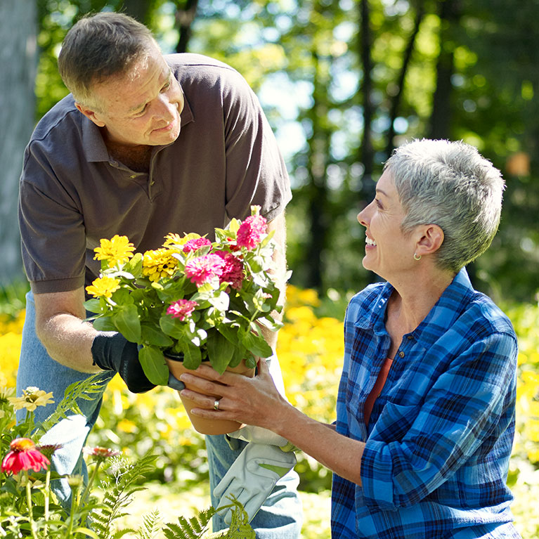 man and woman outside with flowers